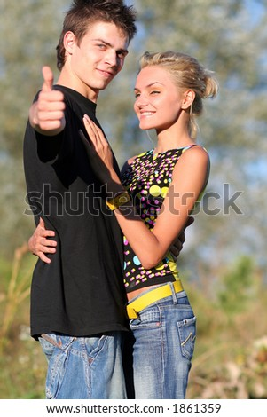 Young cute couple meeting in park
