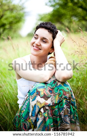 young cute girl resting on fresh spring grass