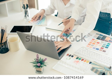 Young cute Graphic designer using graphics tablet to do his work at desk Foto stock ©