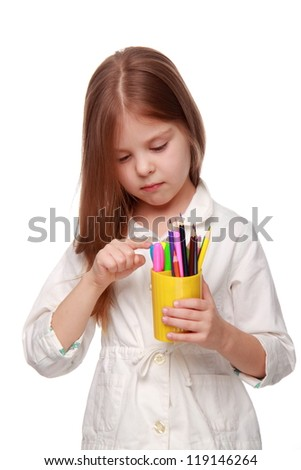 Young cute little girl with pencils