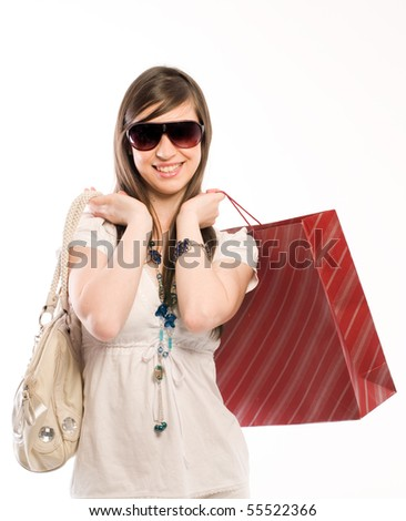 Young cute woman holding shopping bags