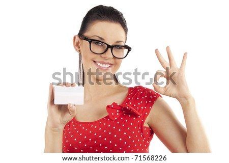 young cute woman in red dress and a small white card making a ok sign - stock photo
