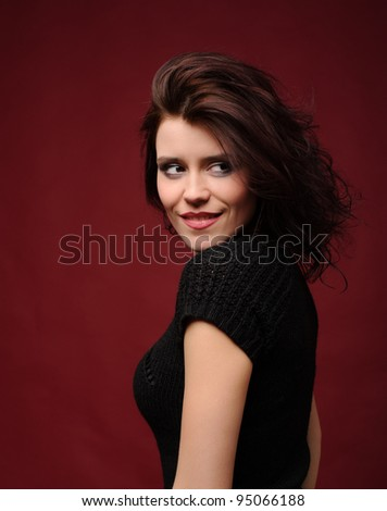 Young cute woman on a red background - stock photo