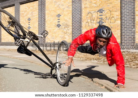 young cyclist having an accident on his bike #1129337498