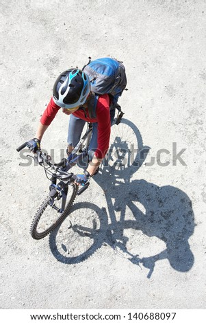 Young cyclist on a mountain bike  in the park