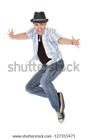 Young dancer in mid air jump with arms outstretched