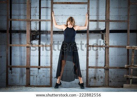 Young dancer taking a modern dance performance in an urban industrial surrounding