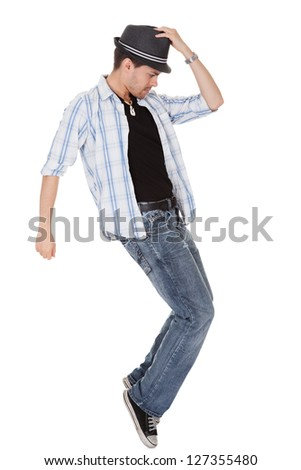 Young dancer touching his hat and one arm outstretched
