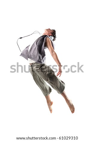 Young dancer wearing headphones and jumping