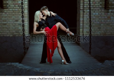 Young dancers perform Argentine tango. Dance of passion in the evening on a date a pair of lovers. #1112533676