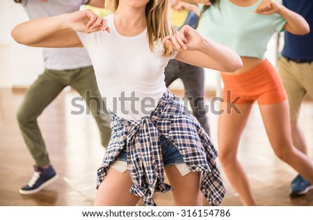 Young dancing people in gym during exercise dancer workout training with happy fresh energy. #316154786