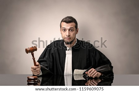 Young dashing judge in black gown making decision with no concept Foto d'archivio ©