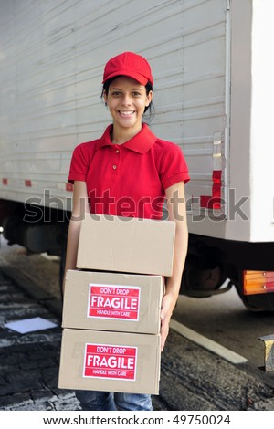 young delivery courier or mover delivering cardboards