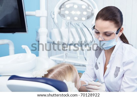 Young dentist at work in the office