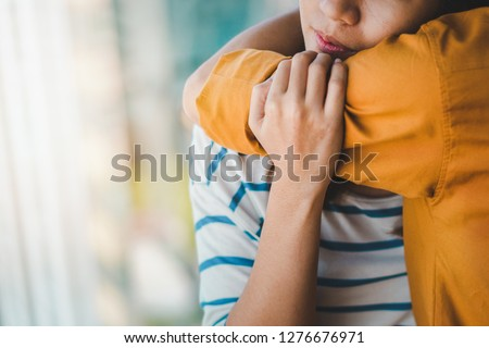 Young depressed asian woman hug her friend for encouragement, Selective focus, PTSD Mental health concept.