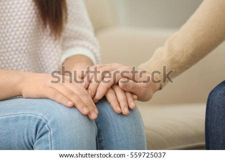 Young depressed woman at psychologist's office, closeup