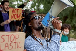 young diverse people protest with placards and posters on global strike for climate change. save our planet from plastic pollution