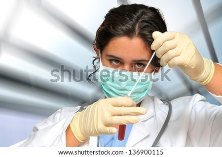Young doctor analyzing a blood sample