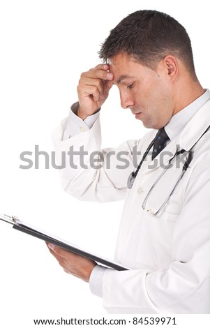 young doctor banging his head realizing a mistake and looking worried