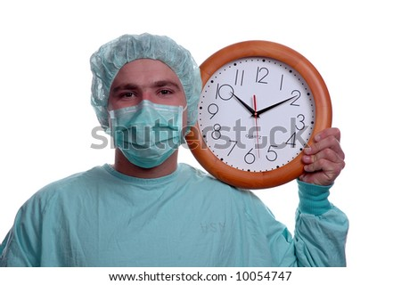 young doctor holding wall clock over white
