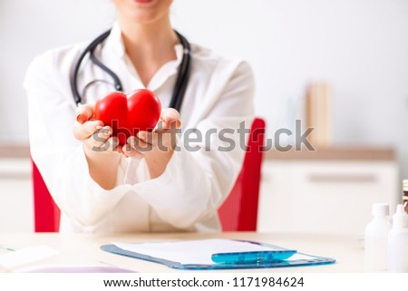 Young doctor in heart care concept #1171984624