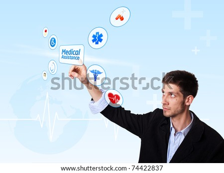 Young doctor pressing Medical Assistance button, futuristic technology