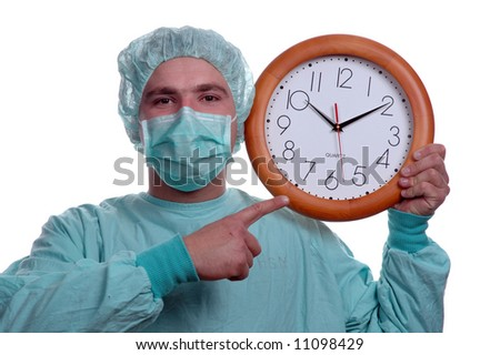young doctor showing clock isolated