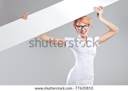 Young doctor showing empty board