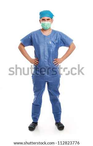 Young doctor standing on white background