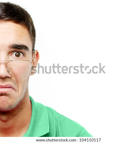 Young doctor wearing glasses with a surprised face over white monochrome background