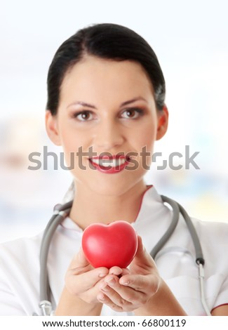 Young doctor with heart in her hand