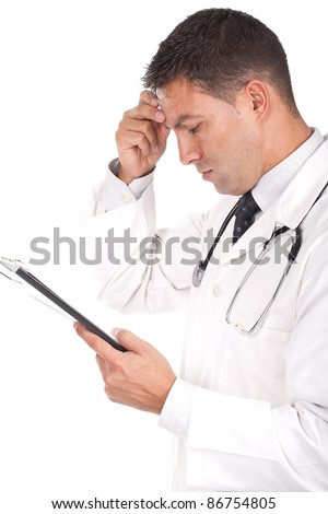 young doctor with his hand in his head and looking worried