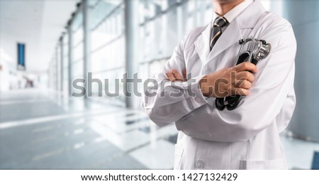 young doctor with hospital background #1427132429