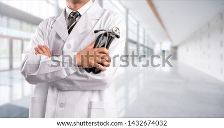 young doctor with hospital background #1432674032