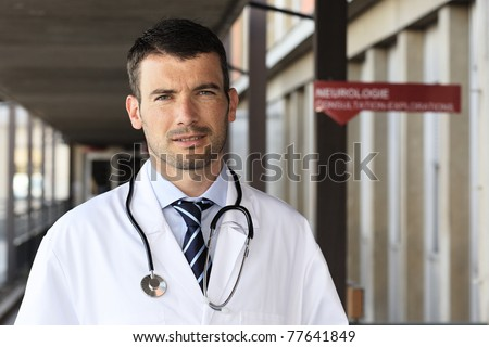 young doctor with stethoscope in hospital hall