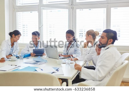 Young doctors in computer workshop work together in cooperation #633236858