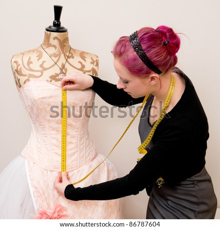Young dressmaker in her studio
