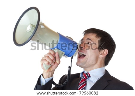 Young dynamic businessman shouts into megaphone loudly.Isolated on white background.