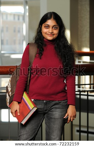 Young Eastern Woman Holding a Book inside a College Building