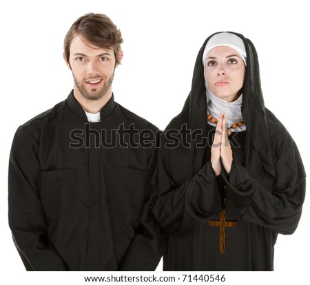 Young easygoing priest with nun praying with white background
