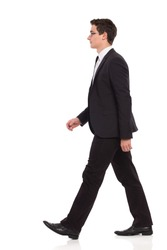 Young elegance man walking. Full length studio shot isolated on white.