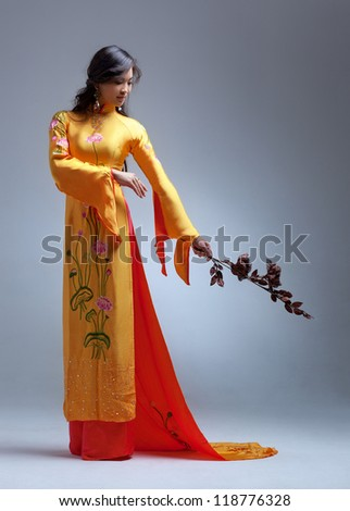 Young elegant asian woman in traditional clothing.