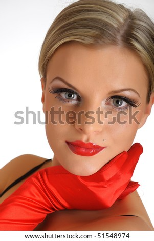 Young elegant beauty female face with red shiny lips and black eye makeup. colse-up.