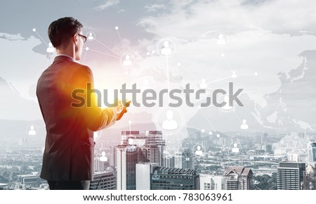 Young elegant businessman with diary in hands looking away #783063961
