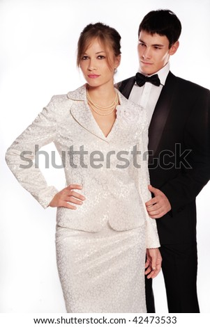 young elegant couple, studio shot on white