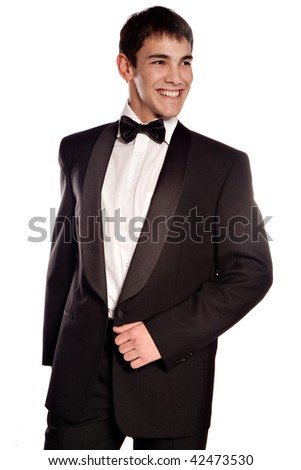 young elegant smiling man in tuxedo, studio on white