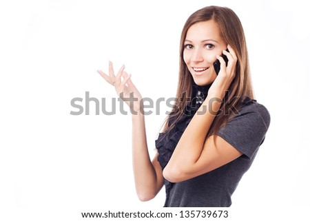 Young elegant woman talking on mobile phone against white background - stock photo