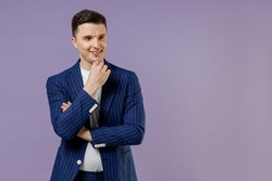 Young employee business man lawyer 20s wear formal blue suit white t-shirt work in office put hand prop up on chin lost in thought and conjectures isolated on pastel purple background studio portrait
