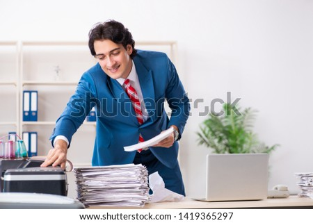Young employee making copies at copying machine  #1419365297