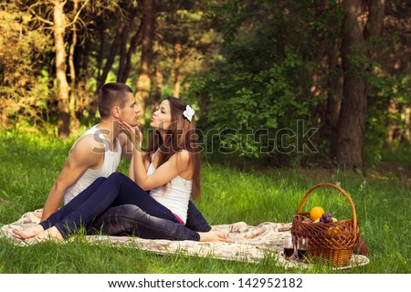young enamoured couple on rest in park